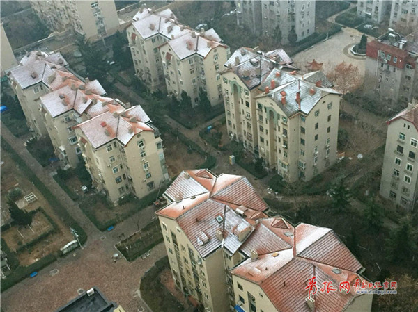 Qingdao welcomes first snow of the New Year